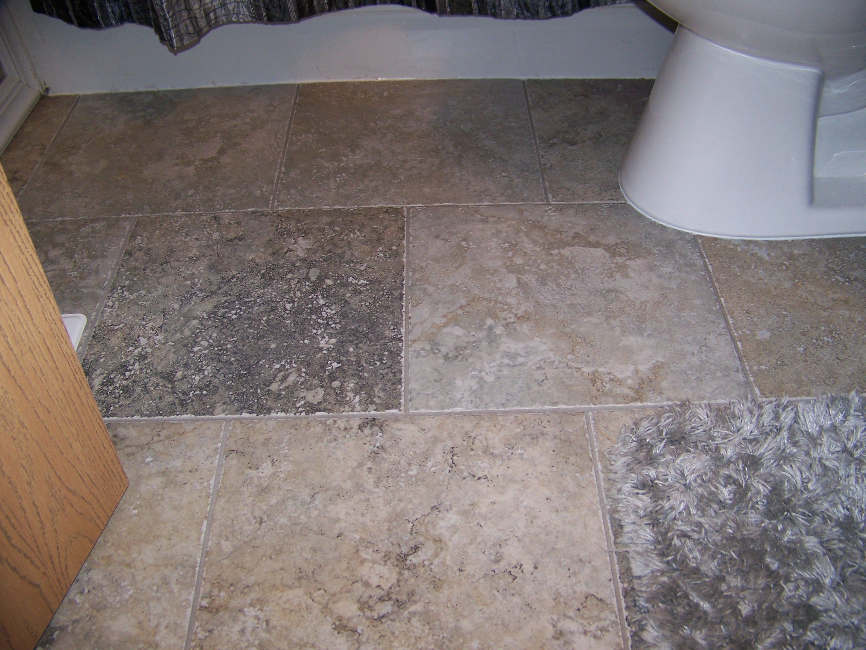 Ceramic floors twelve stones tile laminate installation for Ceramic laminate flooring